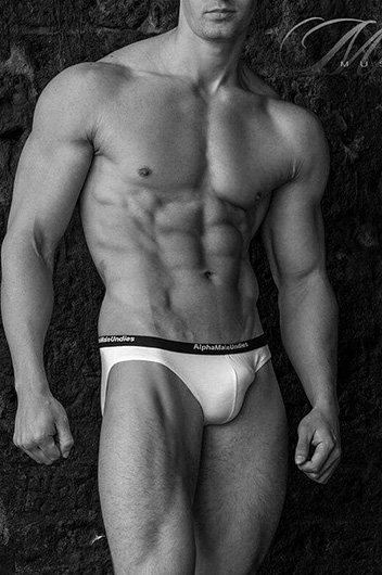 muscular white male standing in white underwear