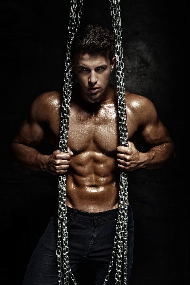 tie and tease masseur - muscular male standing holding on to chains