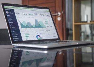 laptop showing data graphs