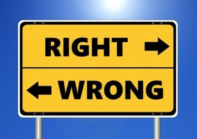 ethics of male massage: sign reading 'right' and 'wrong' and pointing in opposite directions