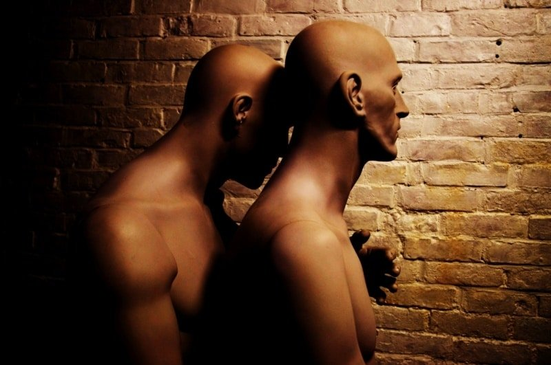 gay masseur in london: an erotic adventure - a male mannequin kissing another male mannequin's neck