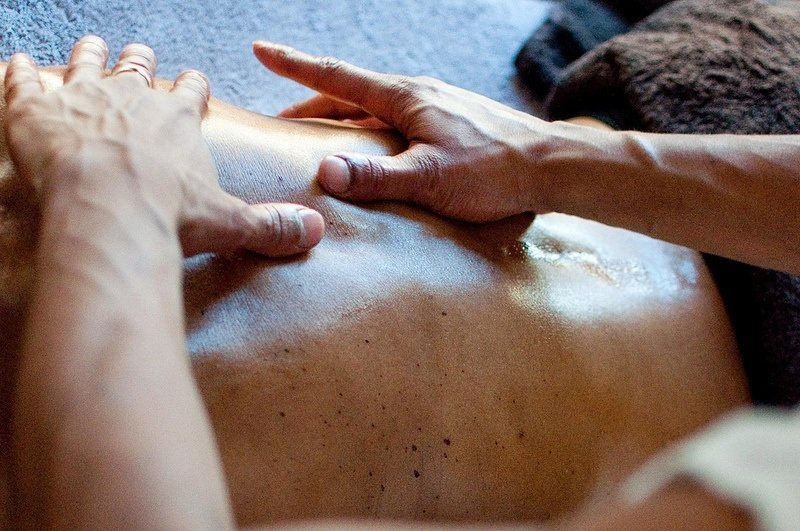 male receiving a back massage