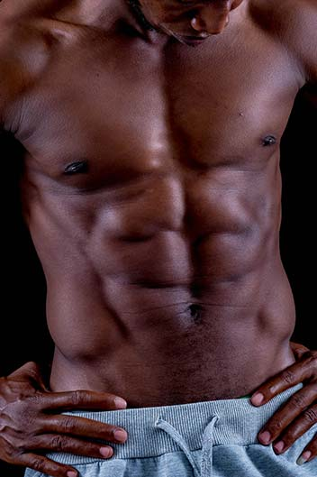 Masseur Jermaine: muscular black man in grey shorts