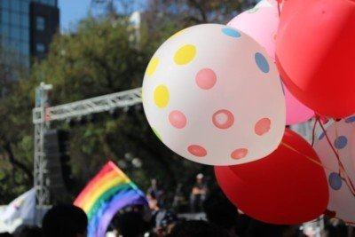 Gay marriage celebration in Taiwan with balloons and a flag