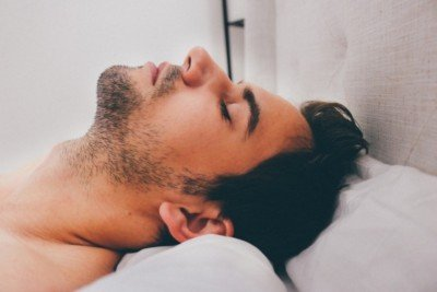 Myths about male massage in London: male lying down for massage