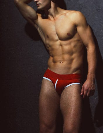masseur in red swim briefs ready for wet and wild bathing ritual