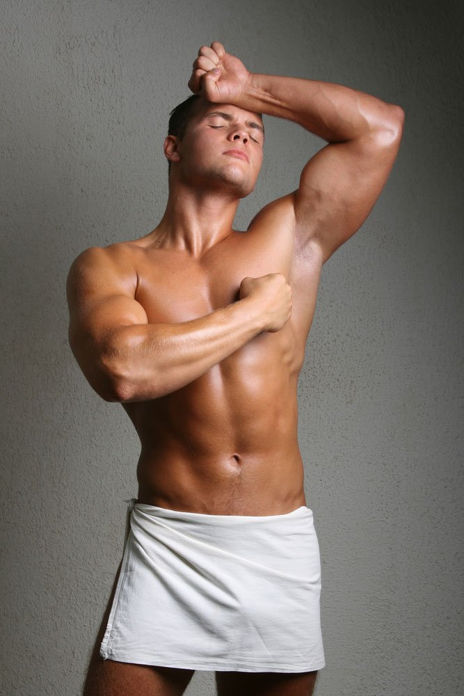 white male standing, wearing a white towel around his waist ready for gay nuru massage