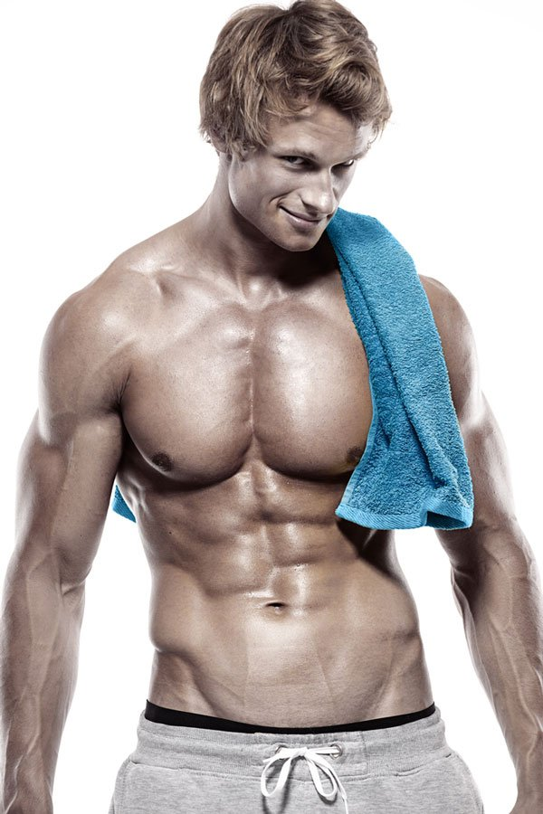 blond male with towel draped over his shoulder in preparation for sensual sports massage