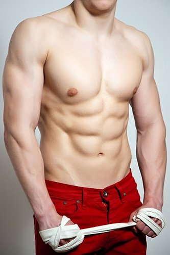 masseur adam : muscular white male in red trousers, holding sports tape