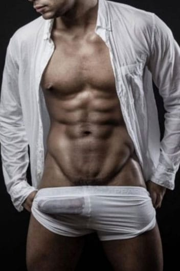 masseur anthony : a muscular mixed race male wearing white trunks and an unbuttoned white shirt