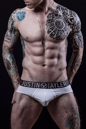 masseur brett : muscular white male with tattoos wearing white briefs
