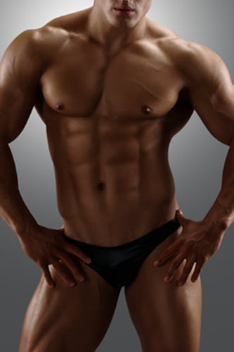 masseur christopher : white male with a very muscular body wearing black briefs