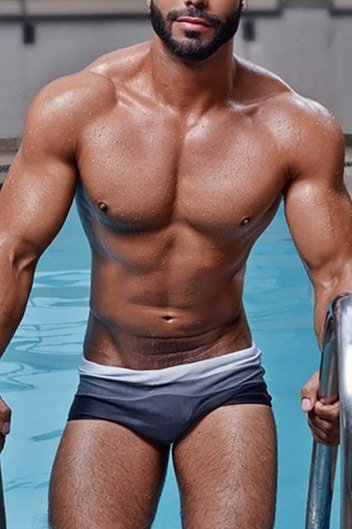 masseur jordan : muscular latin male stepping out of a swimming pool in grey trunks