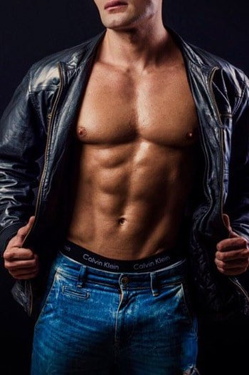 masseur luis : muscular white male wearing jeans and holding his leather jacket open to expose his torso