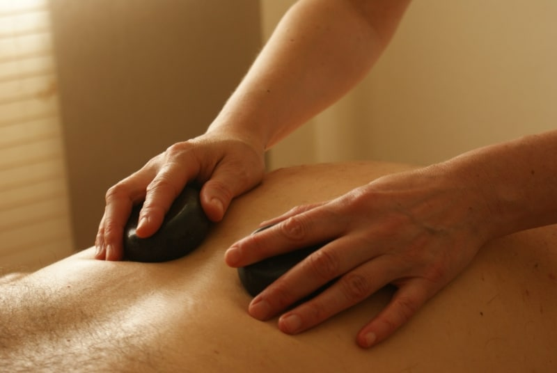 akward moments in massage: male flinching under hot stones