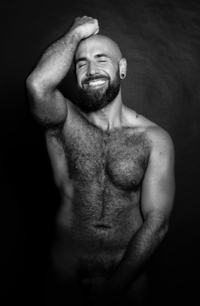 hairy male smiling