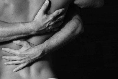 tantric masseurs embracing