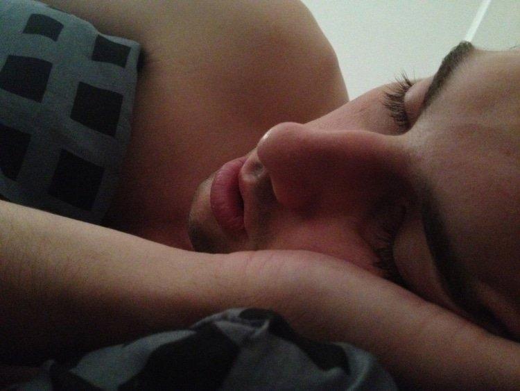 male sleeping in bed