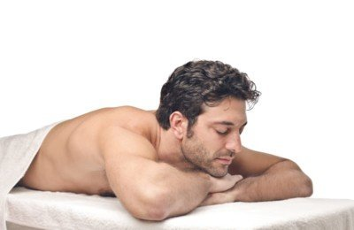 male receiving massage to help him sleep