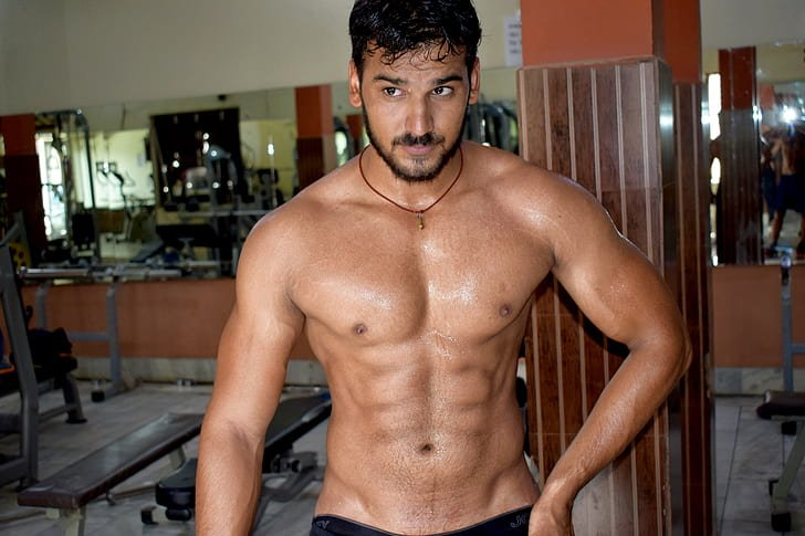 muscular male in the gym