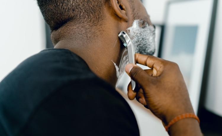 male shaving in the morning